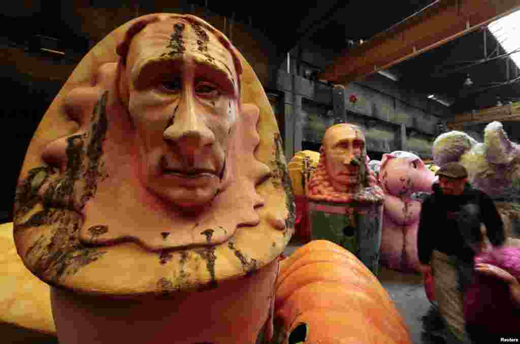 Figures of Russian President Vladimir Putin are seen during preparations for the carnival parade in Nice, France. (Reuters/Eric Gaillard)