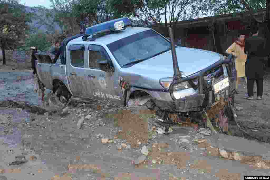 A damaged police vehicle was mired in the mud in Charikar.