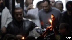 Сирия. Свечи в память о тележурналисте Жиле Жакье, убитом 11 января в городе Хомс