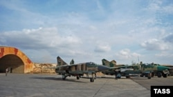 A MiG-23 fighter aircraft of the Syrian Air Force prepares for a flight at Hama air base, November 7, 2015