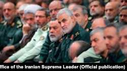 Oct. 2, 2019 photo, released by an official website of the office of the Iranian supreme leader, showing Qassem Soleimani in the center.