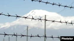 Barbed wire, pictured against the backdrop of Mount Ararat, marks Armenia's closed border with Turkey.