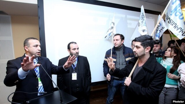 Armenia - Anti-government activists disrupt a conference on pension reform, Yerevan, 21Feb2014.