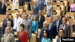 Duma deputies standing for the hymn on June 11.