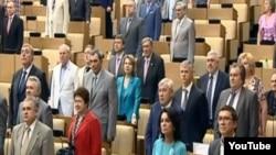 Duma deputies standing for the hymn on June 11.