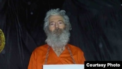 PHOTO GALLERY: Five photos of Robert Levinson sent to his wife, Christine, in April 2011.