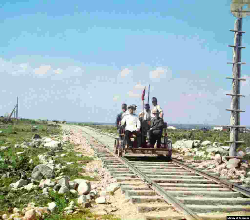 Prokudin-Gorsky and others ride the Murmansk Railroad in a handcar along the shores of Lake Onega in 1915. - Prokudin-Gorsky photographed railroad bridges, locomotives, barges, steamers, and canals, emphasizing technological achievements and the importance of the transportation system tying together the vast Russian Empire.