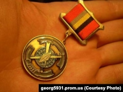 Russian medal with emblem of GRU military unit No. 74455