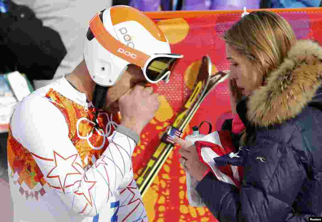 U.S. skier Bode Miller (left) and his wife Morgan Beck cry in the mixed zone after finishing in the men's alpine skiing Super-G competition. (Reuters/Leonhard Foeger)