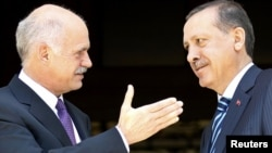 Greek Prime Minister George Papandreou (left) greets his Turkish counterpart Recep Tayyip Erdogan in Athens.