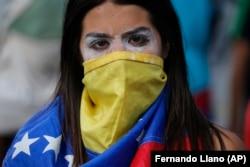 Студентка одного из университетов Каракаса на антиправительственной акции. Сентябрь 2019 года