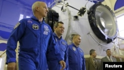NASA astronaut Jeff Williams (left to right) and Russian cosmonauts Oleg Skripochka and Aleksei Ovchinin attend a training examination at the Gagarin cosmonaut training center outside Moscow in February.