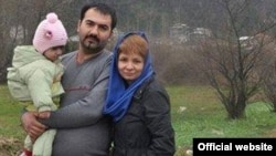 Soheil Arabi is pictured with his family in an undated photograph