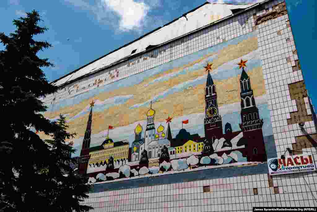 A mural of Moscow in winter decorates the side of a building in the center of Dzerzhynsk. A year ago, this was the scene of heavy fighting between government forces and Russian-backed separatists.