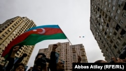 Would-be voters wave an Azerbaijani flag in downtown Baku four days ahead of the October 9 election.