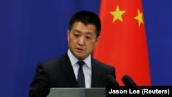 CHINA -- Chinese Foreign Ministry spokesman Lu Kang answers questions about a major bus accident in North Korea, during a news conference in Beijing, April 23, 2018