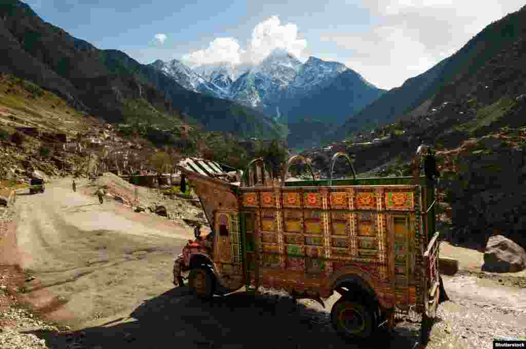 "Elaborately decorated trucks rumble over even the most isolated roads of Pakistan. This ""jingle truck"" is headed down the Karakoram highway."