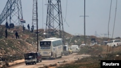 Колона транспорту, який вивозив людей зі східної частини Алеппо, 16 грудня 2016 року