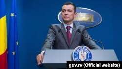 Romanian Prime Minister Sorin Grindeanu says he will remain in office until a new government is installed.