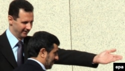Syrian President Bashar al-Assad (left) welcomed Iranian counterpart Mahmud Ahmedinejad to Damascus for a meeting in February 2010.