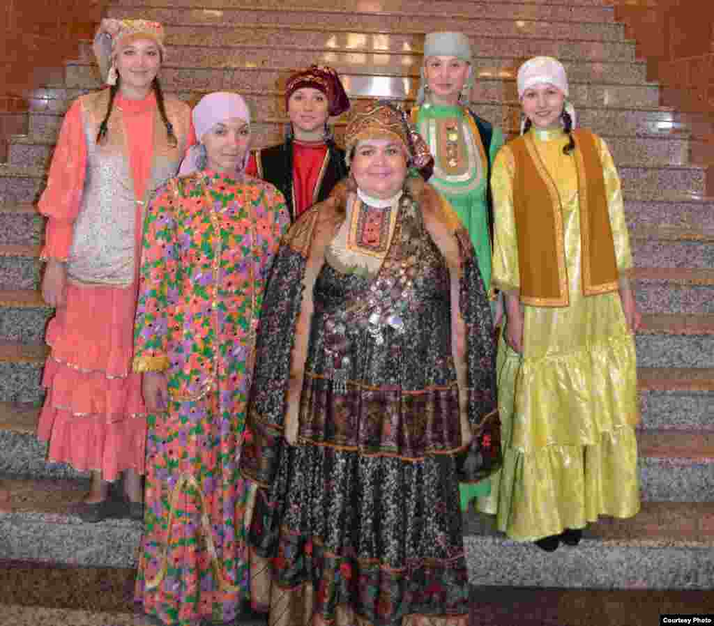 The National Museum staff in ethnic dress