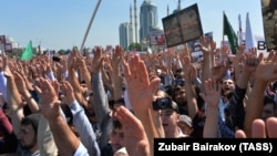 Muslims rally in Grozny's Akhmat Kadyrov Square in support of Rohingya Muslims in Burma on September 4.