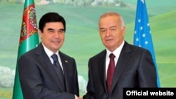 """What'd you say your name was again?"" The Turkmen and Uzbek presidents, Gurbanguly Berdymukhammedov (left) and Islam Karimov, press the flesh in Tashkent."