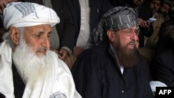 Taliban negotiators Maulana Samiul Haq and Ibrahim Khan