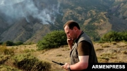 Armenia - Minister for Emergency Situations Davit Tonoyan coordinates firefighting efforts at the Khosrov nature reserve, 14Aug2017.