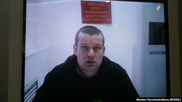 Leonid Razvozzhayev appears via video link at the Moscow City Court on January 21.