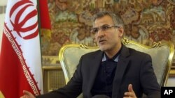 In this Saturday, July 4, 2015 photo, Tehran's ambassador to Kabul, Mohammad Reza Bahrami, speaks during an interview with The Associated Press at the Iranian embassy in Kabul, Afghanistan. As Iran and global powers move toward a nuclear agreement, Brahi
