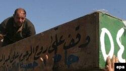 Похороны жертв крупного взрыва в шиитском районе Багдада, произошедшего в четверг
