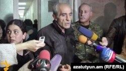 Armenia - Yeghishe Gevorgian and his wife Ruzanna (L) speak to journalists after their repatriation from Azerbaijan, Yerevan, 12Dec2014.