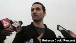 Former U.S. Marine Amir Hekmati is suing Iran over torture he says he endured while jailed in Evin Prison in Tehran.