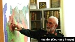 تصویری که خبرگزاری تسنیم منتشر کرده و حسین همدانی را ظاهرا در حال فرماندهی جنگ در سوریه نشان میدهد.