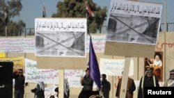 Бакуба шаарында вице-президент Тарик Ал-Хашемини жоопко тартууну талап кылгандардын демонстрациясы өттү. 20-декабрь, 2011-жыл.