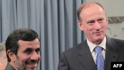 Iran President Mahmud Ahmadinejad (left) with Russian National Security Council secretary Nikolai Patrushev during a meeting in Tehran on August 16
