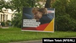 Передвиборчий плакат із зображенням Анґели Меркель