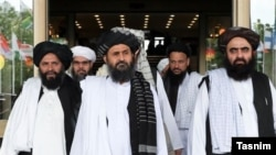 FILE: Taliban deputy leader Mullah Abdul Ghani Baradar (C) with members of the Taliban political office in Qatar.