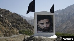 Slain national hero Ahmad Shah Masud, pictured here on a banner beside a mountain pass, is one of many top names mentioned in the report.
