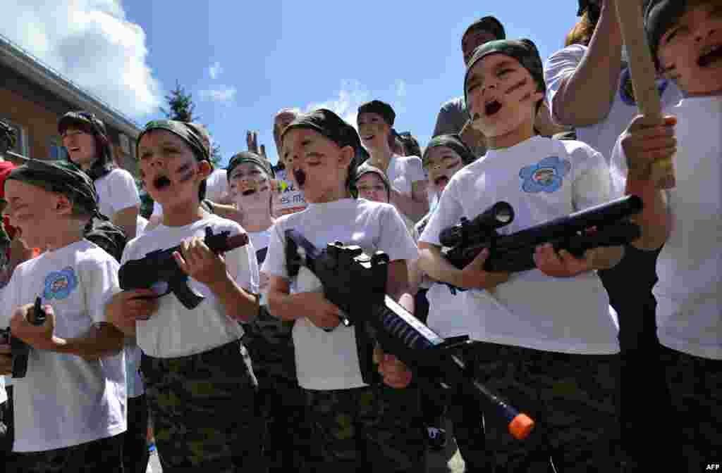 Children shout as they hold toy rifles during a patriotic military game called Zarnitsa in a kindergarten in Stavropol, Russia. (AFP/Danil Semyonov)