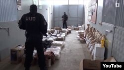 Armenia - A screenshot of official video of security officers finding large stockpiles of food in a villa belonging to retired General Manvel Grigorian, 17 June 2018.