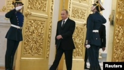 Russia -- Russian President Vladimir Putin walks past honor guards as he attends a ceremony to receive diplomatic credentials from foreign ambassadors at the Kremlin in Moscow, November 26, 2015