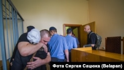 Halko hugs his mother at his court appearance in MInsk on July 17.