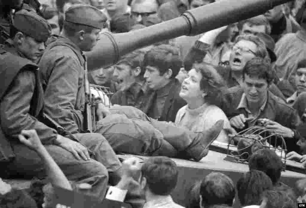 A Czechoslovak woman talks to Soviet soldiers on a tank as she protests against the invasion in Prague.