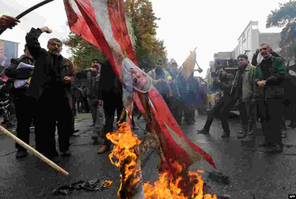Iranians burn U.S. flags outside the former U.S. Embassy in Tehran on November 4, 2014.