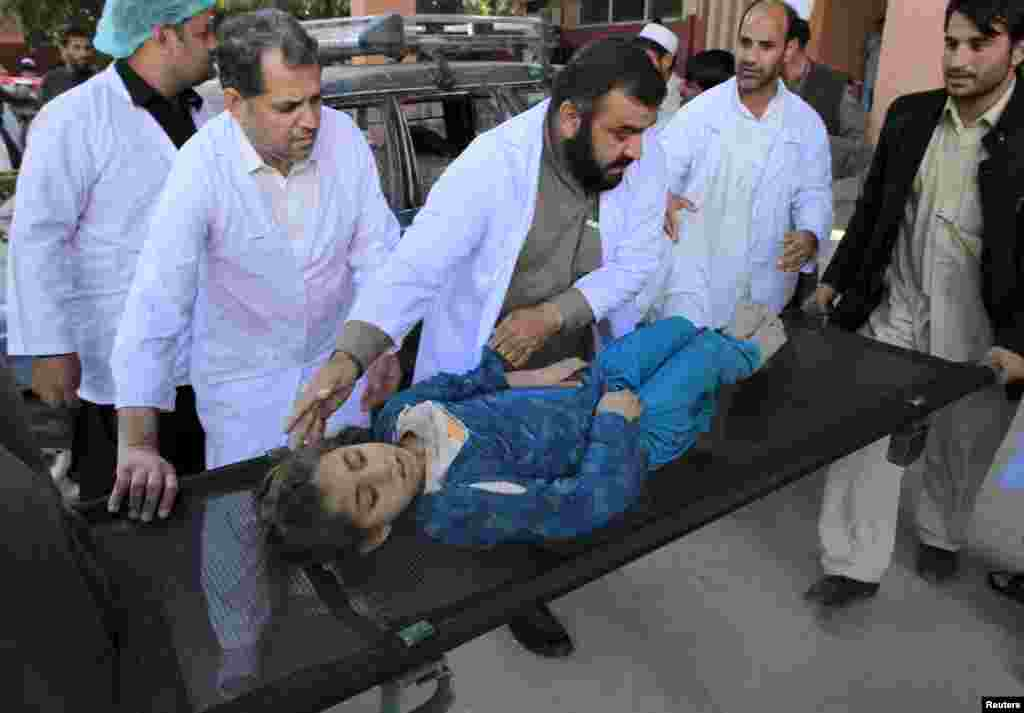 Rescue workers move an injured girl at a hospital in Jalalabad, Afghanistan.