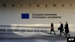 Belgium -- People walk in front of the European Union Commission building at the EU Headquarters in Brussels, 08Feb2011