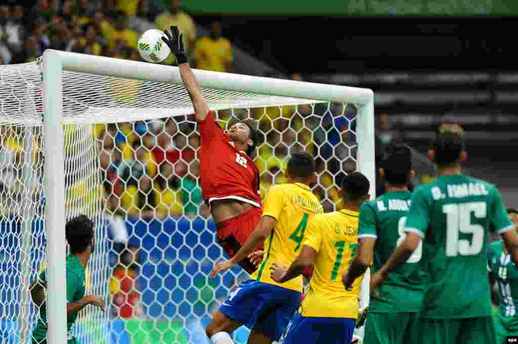 Iraq tries to block the ball during its Group A soccer match against Brazil.