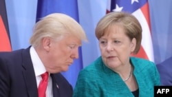 German Chancellor Angela Merkel (right) and U.S. President Donald Trump speak during a panel discussion at the G20 summit in Hamburg last week.